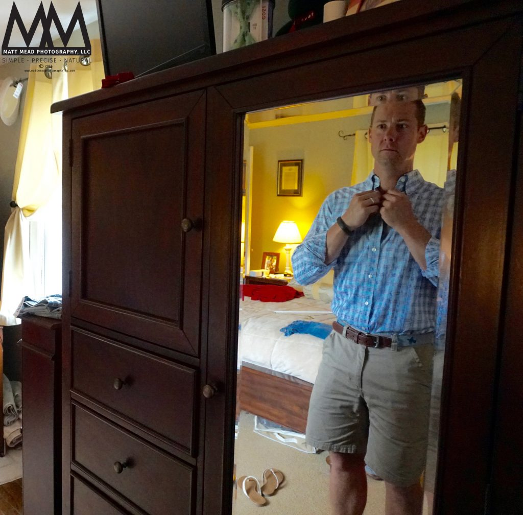 man getting dressed for family portrait photo session in Ligonier, PA