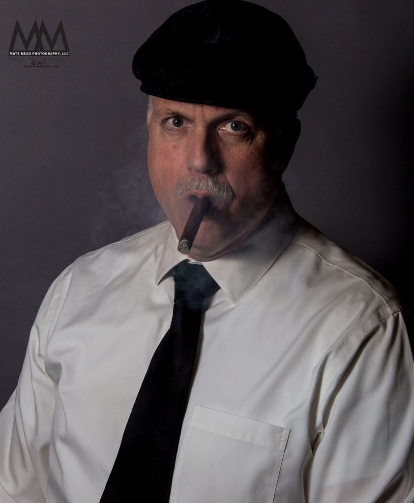 portrait of man smoking a cigar in Erie PA headshot session