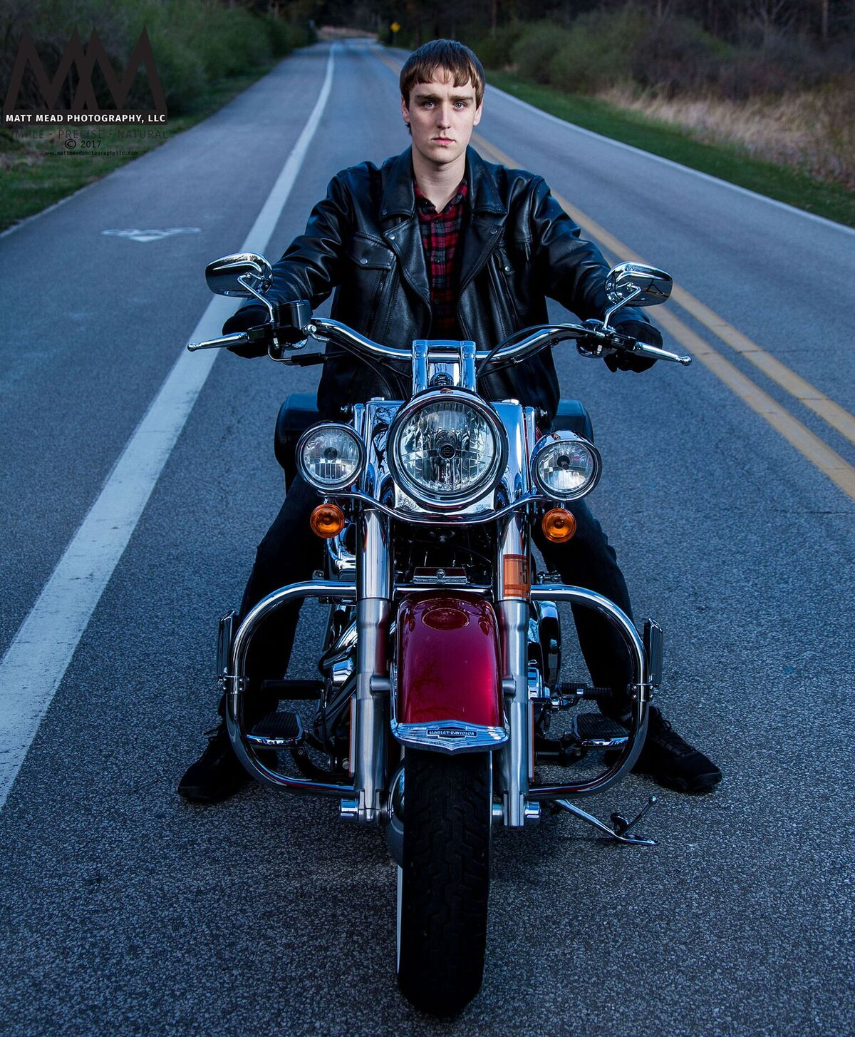teen poses on motorcycle Erie PA senior portrait session at Presque Isle state Park
