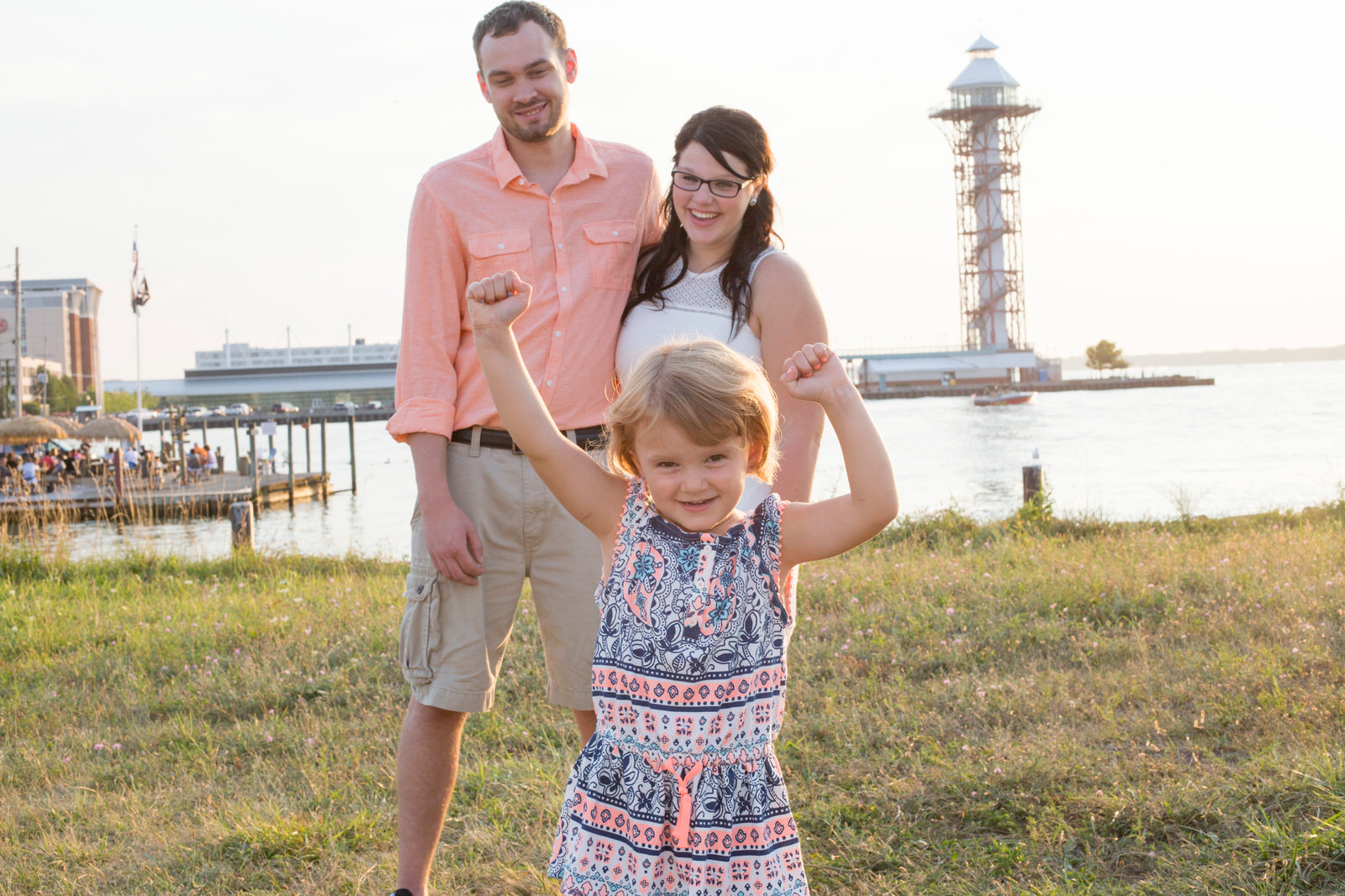 Couple watches and laughs as child dances on Dobbins Landing in Erie, PA