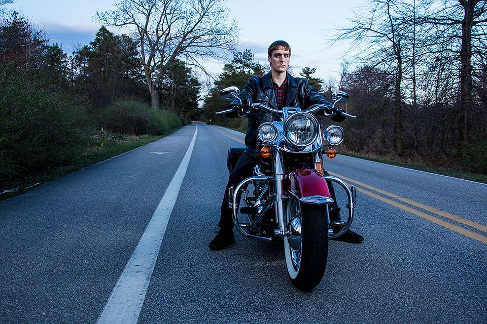 Senior portrait of young man riding a motorcycle on Presque Isle in Erie, PA