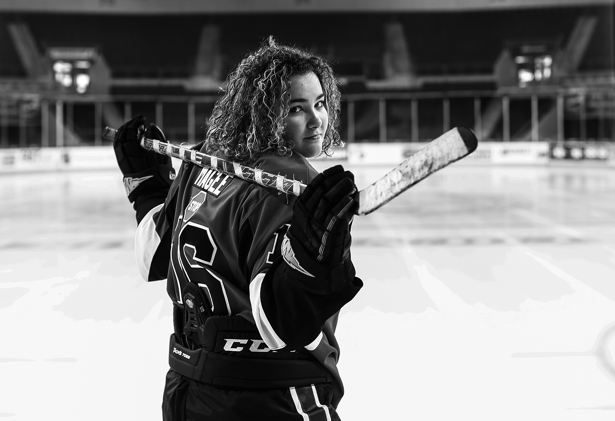 Girl dressed in hockey gear for Erie senior portraits session