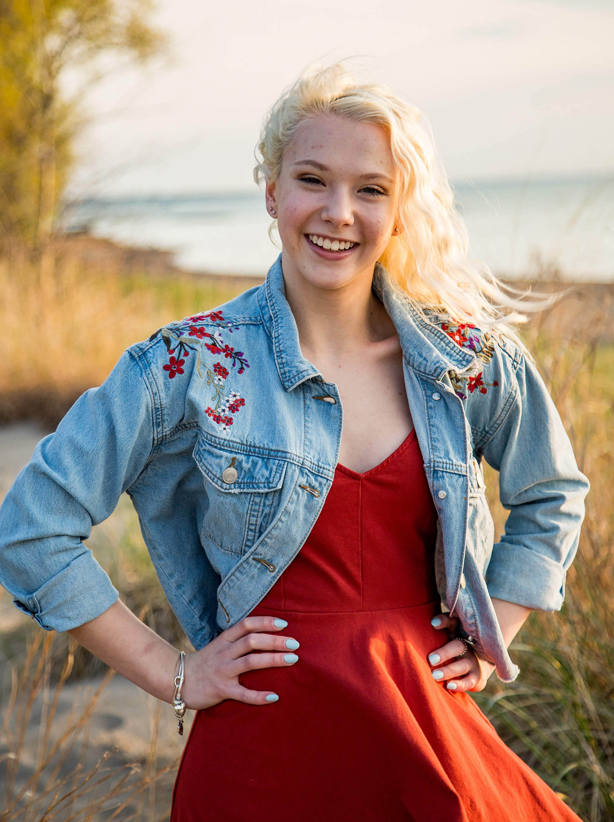 Laughing girl on the beach for Sweet Sixteen photos at Presque Isle State Park