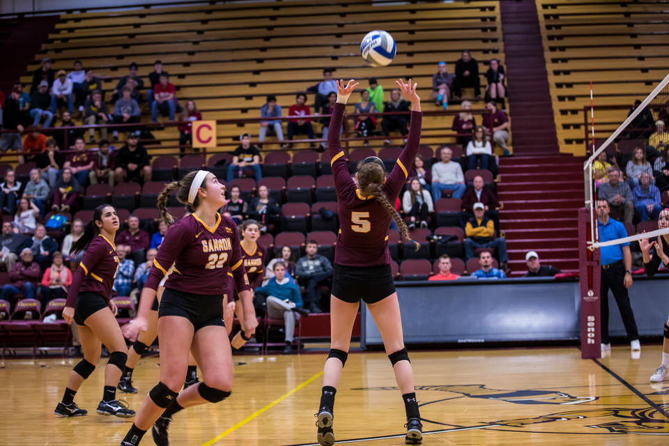 Gannon University's women's volleyball player about to hit the ball