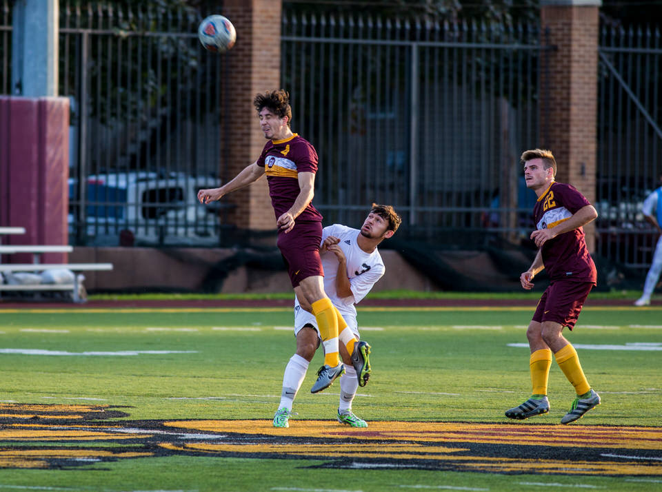 Gannon University men's soccer player heading a soccer ball