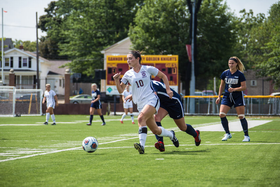 Gannon University's women's soccer player running after the ball
