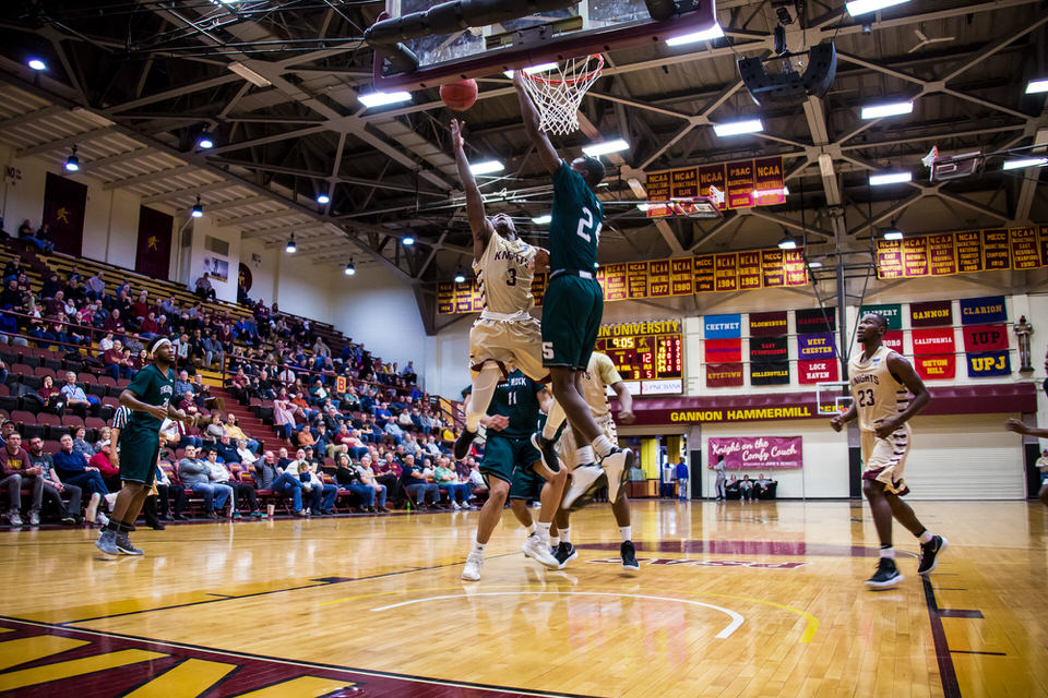 Gannon University's men's basketball player attempting to make a basket