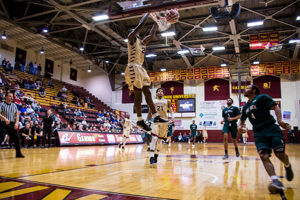 Gannon University's men's basketball player dunking the basketball