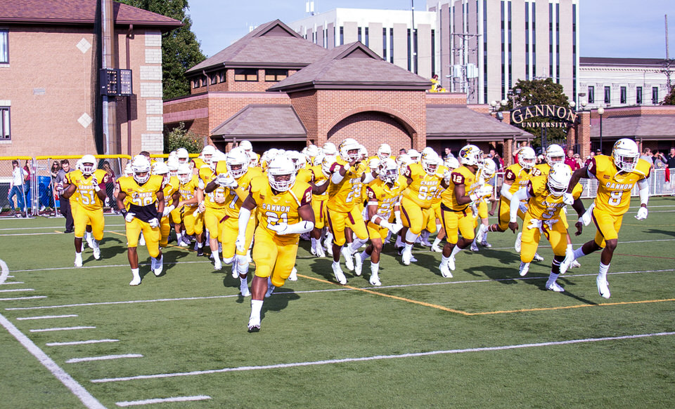 Gannon University's football team taking the field