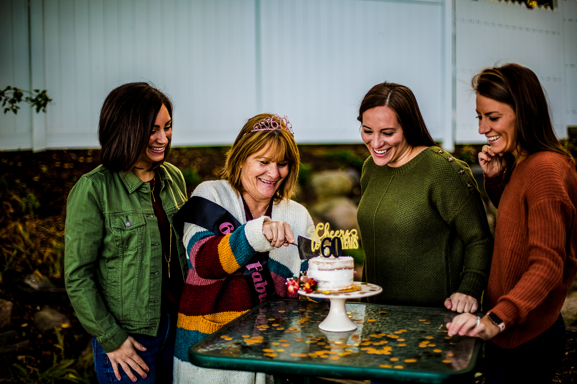 Mom cuts cake for 60th birthday celebration with her daughters in North East, PA