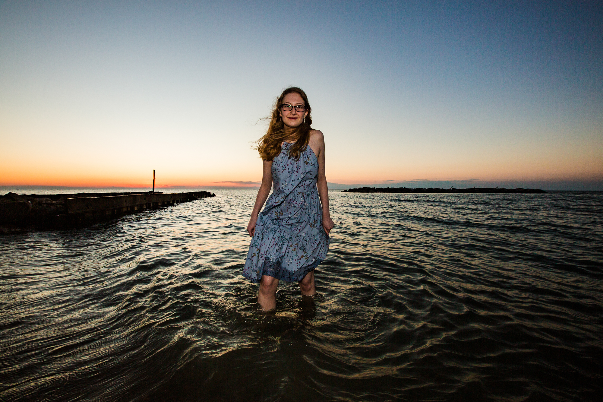 Girl wading in the lake for senior photos in Erie PA