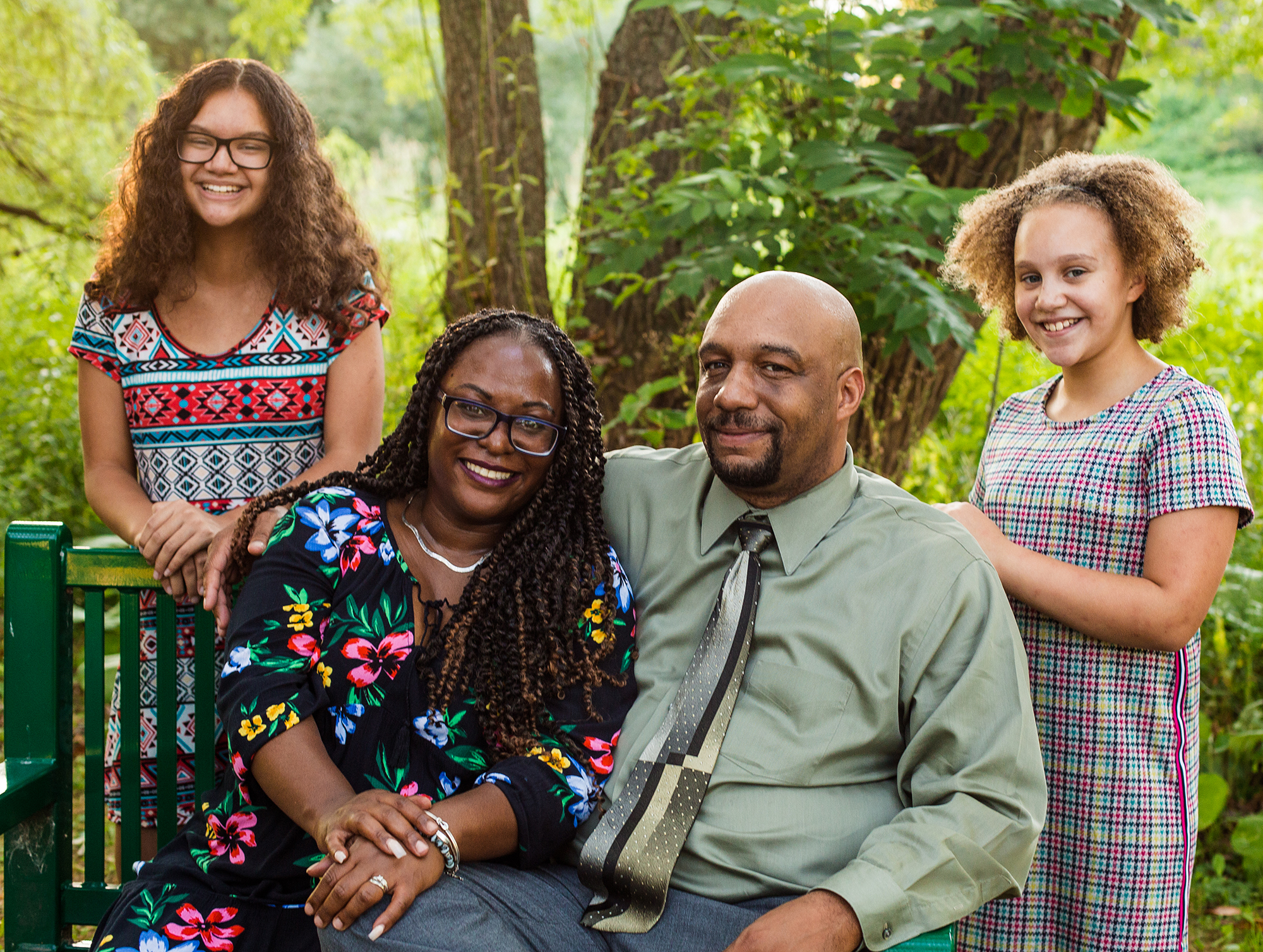 Man, woman, and two girls pose for family portraits at Frontier Park in Erie, PA